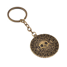 Hot Movie Pirates Of The Caribbean Keychain Vintage Skull Head Gold Skeleton Key Chain(China)