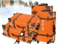 коричневый винтаж тележки багажа чемодан