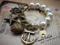 минимальный. $ 10 ретро жемчуг простирание браслет бронза морская звезда море винтажный браслет женщины 123006 к