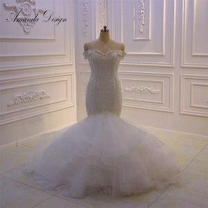 Image 1 - Amanda Design bruidsjurken Off Schulter Spitze Applique Meerjungfrau Hochzeit Kleid