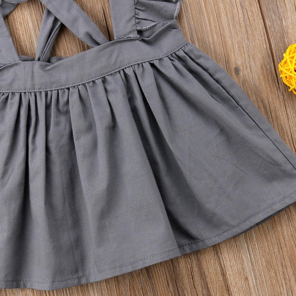 Купить с кэшбэком Girl Dress Kid Baby Girl Cross Strap Dress Party Dress Ruffles Sleeve Solid Dress Clothes