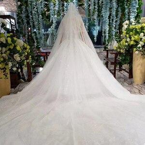 Image 5 - HTL823 فساتين زفاف لامعة مع الحجاب الزفاف الوهم o الرقبة فساتين زفاف طويلة مع الأكمام vestido de noiva 2020