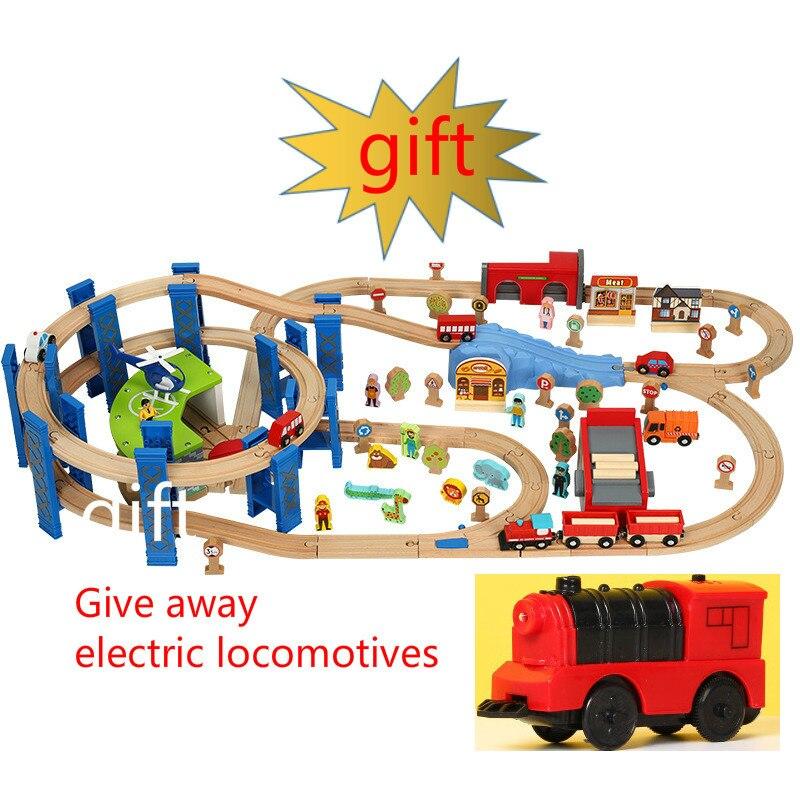 Les grands jouets de voie en bois donnent des cadeaux d'anniversaire pour enfants de voie multicouche annulaire stéréo de Locomotive électrique