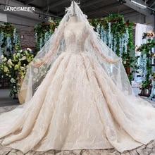 Robe de mariée pour femmes à manches longues, col rond, en tulle, robes de mariée avec plumes, HTL805