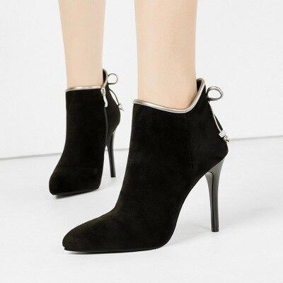 Botines mujer 2019 nuevas botas Martin tacones altos puntiagudos fino con luz de piel flip Qi botas de mujer