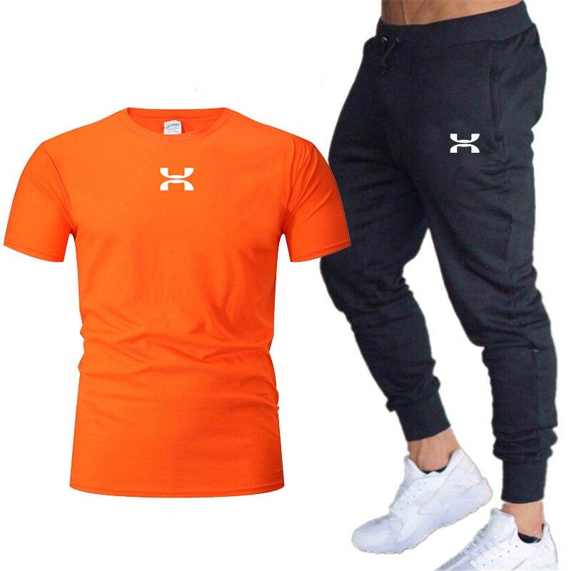 2019 Hot New Cotton Short-sleeved Suit Printing T-shirt Suit + Men's Casual Trousers Sports Jogging Pants Men's Suit M-xxl