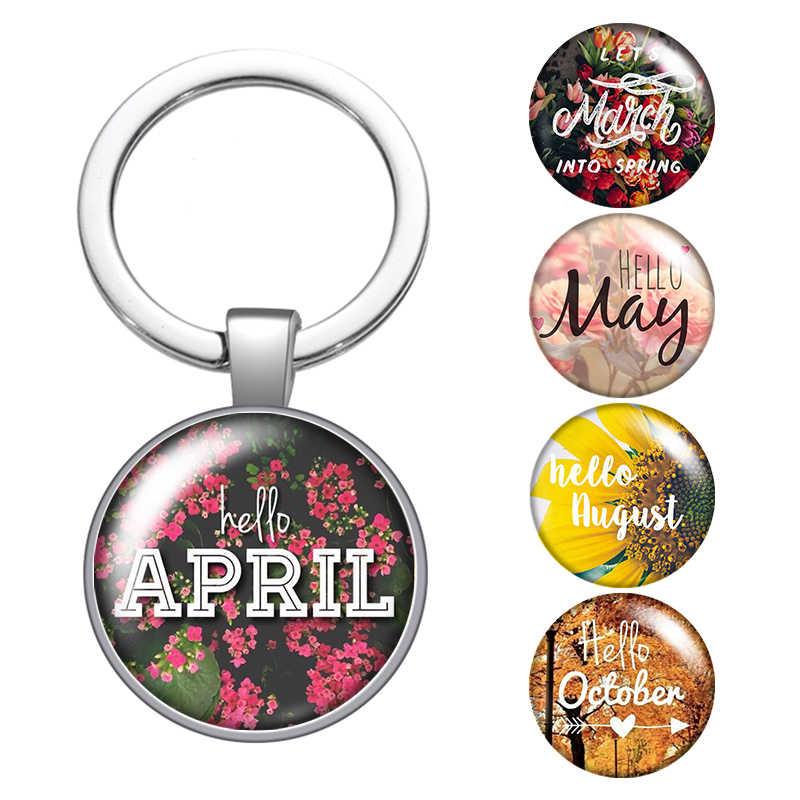 الموسم شهر أبريل مايو يونيو المعزز الزجاج كابوشون حقيبة سلسلة مفاتيح سيارة حلقات المفاتيح حامل الفضة مطلي سلسلة مفاتيح هدايا الرجال النساء