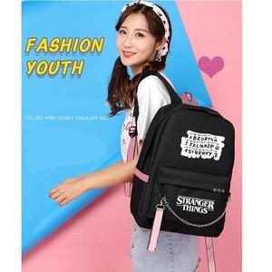 Image 5 - Nouveau étranger choses toile sac à dos USB Charge femmes étudiant sac à dos lettres imprimer sac décole adolescent filles rubans sac à dos