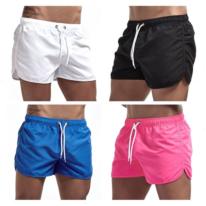 2021 Summer Hot Shorts Men's Solid Color Shorts Men's Summer Loose Breathable Casual Shorts Beach Shorts Large Size