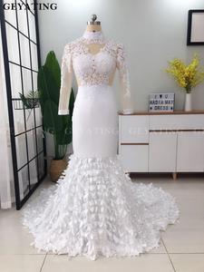 Image 2 - אלגנטי גבוה צוואר ארוך שרוולי בת ים לבן שמלות נשף 2019 אשליה תחרה Applique 3D פרחוני שחור ילדה ארוך סיום שמלה