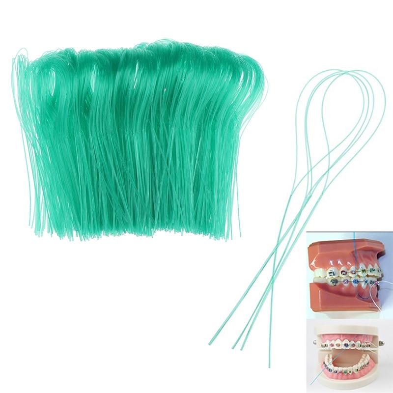 1000 pces ortodontico limpo palito dental floss threader dente suportes de fio