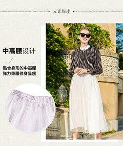 Image 2 - نصف تنورة بيضاء نقية طبقة مزدوجة تنورة غير النظامية التصميم الأصلي الخريف الكتان المرأة فستان