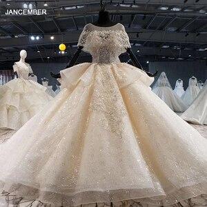 Image 1 - HTL1056 sparkly hochzeit kleid 2020 illusion oansatz perle kleine cape spitze hochzeit kleid plus größe lace up zurück vestido de casamento