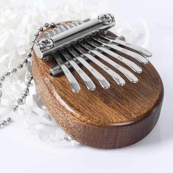 Kciuk fortepian 8-ton Mini Kalimba kciuk fortepian Kalimba kieszeń Kalimba fortepian palec kciuk fortepian z wisiorek prezent świąteczny dla dzieci tanie i dobre opinie CN (pochodzenie) Beginner Other