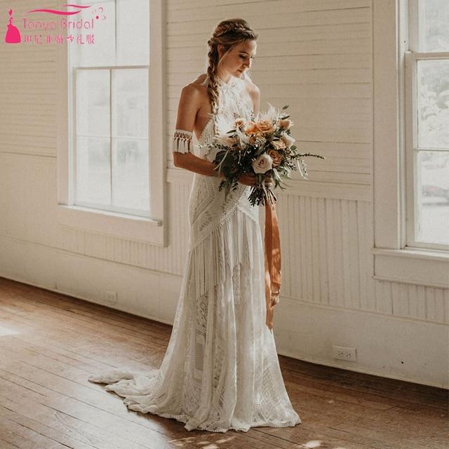 Marzycielski unikalne suknie ślubne Gypsy Hippie uderzające koronkowe suknie ślubne czeski Vestido De Noivas elegancka, z frędzlami ZW229