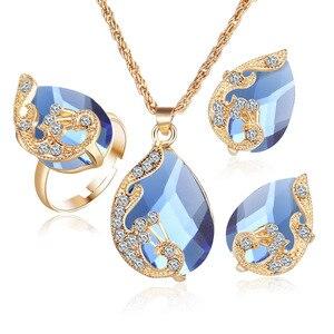 Banhado a ouro cristal austríaco gota pavão três peças pingente colar orelha anel prisioneiro terno feminino conjunto de jóias.