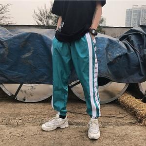 Image 5 - Pantalon large à rayures latérales Jogger hommes Harajuku pantalons de survêtement mode pantalon décontracté Hip Hop pantalon Streetwear piste 2018 été automne