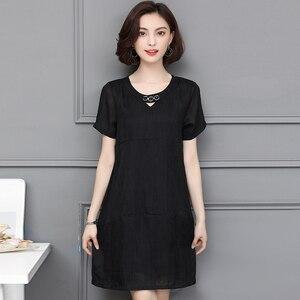 Image 5 - L 5XL ビッグサイズのオフィスの女性カジュアルパーティールース O ネック半袖プラスサイズ夏黒カーキエレガントな女性のカクテルドレス