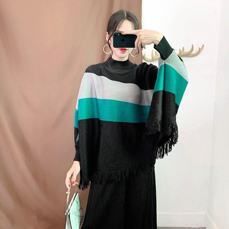 Camisetas de talla grande Miyake plisado con borlas Tops 2019 Otoño e Invierno rayas de cuello alto sueltas talla grande 100 kg puede usar