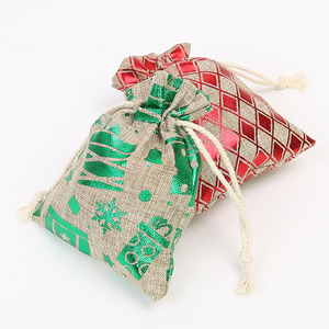 Image 4 - 50Pcs קריקטורה חג המולד חם ביול צרור כיס 9*12 Cm חג מתנת ממתקי תכשיטי אחסון תיק