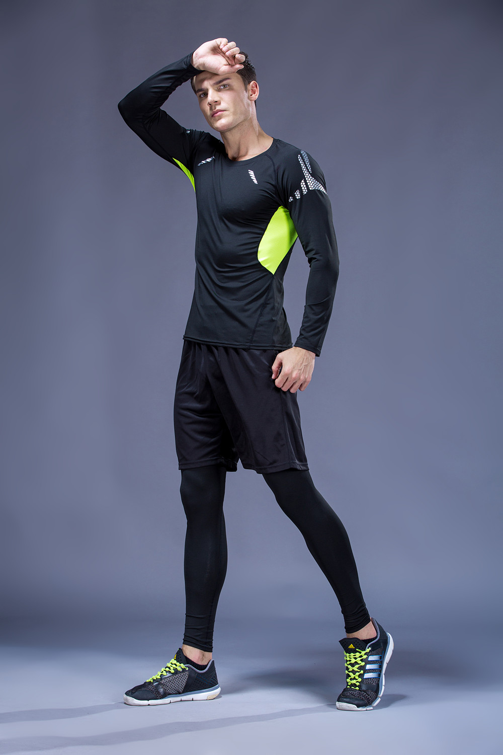 Foto from the right 5 pcs compressions clothes for gym. Men's 5 pcs compression tracksuit sports