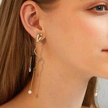 The devils eyelash has a long pearl earring tassel earrings  statement big