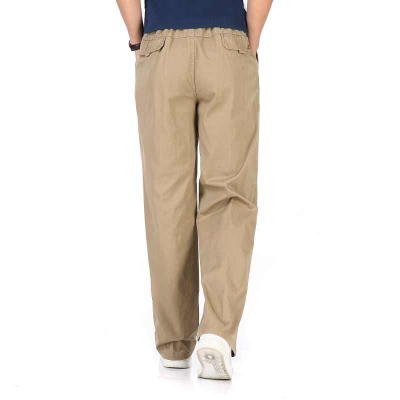 Jesienne zimowe męskie spodnie dorywczo bawełniane proste spodnie pełnej długości 6XL Khaki ciepłe grube workowate taktyczne męskie spodnie Plus rozmiar