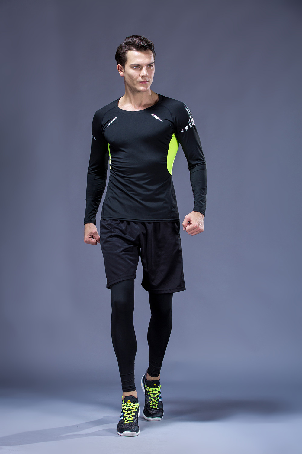 Foto from the front 5 pcs compressions clothes for gym. Men's 5 pcs compression tracksuit sports