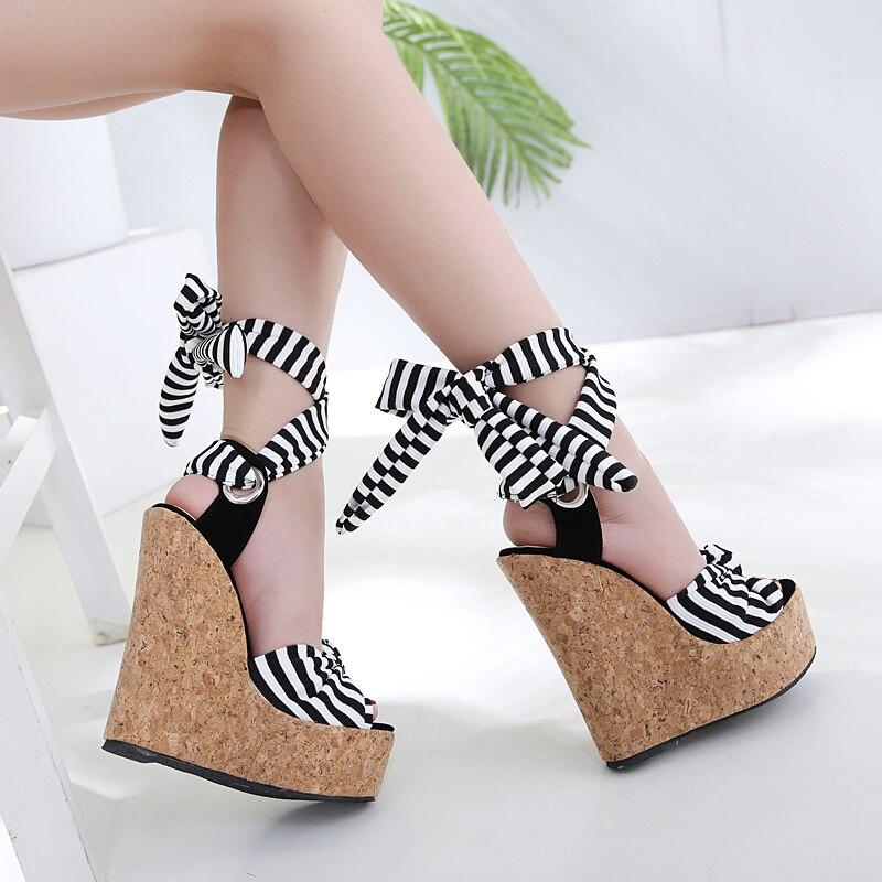 Купить с кэшбэком NIUFUNI 2020 Women's Stripe Ankle Strap Summer Gladiator Sandals Wedges High Heels Sexy Peep Toe Platform Woman Roman Shoes 16cm