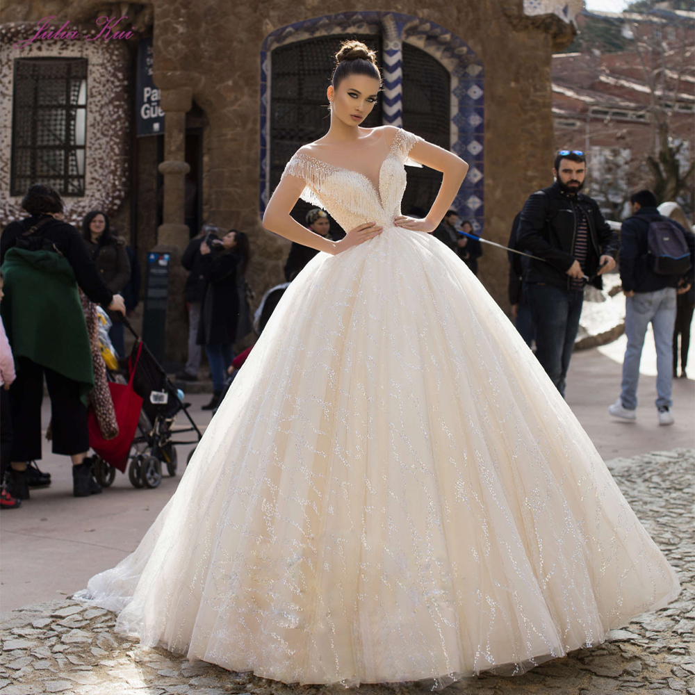 Julia Kui Luxury Shiny Bling Tulle Illusion O-Neck Ball Gown Wedding Dresses With Beading Pearls Tassel Backless Bride Gowns