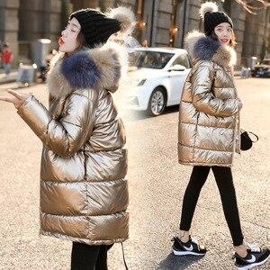 Image 1 - 2019 New Women Winter Down Jacket Chic Big Fur Warm Ultra Light Long Coat Female Parka Hooded Glossy Jackets Oversized