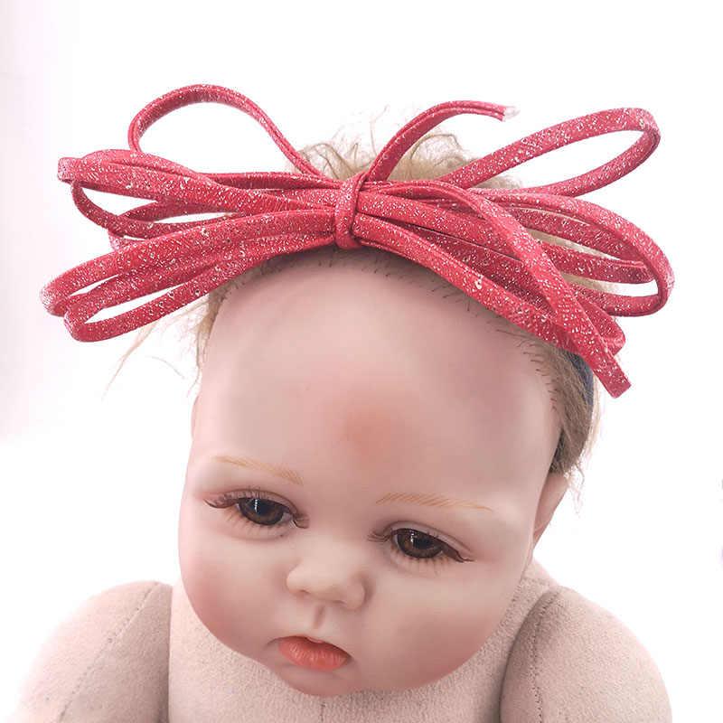 Pasgeboren baby meisjes Lederen Boog hoofdbanden Kids Childs Zuigelingen Prinses Nylon Elastische haarbanden Haar Accessoires Pasgeboren Geschenken
