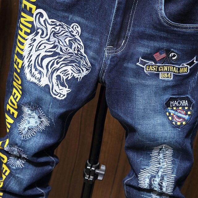 Pantalones vaqueros ajustados para hombre, pantalones ceñidos con estampado de motorista azul, informales, de chándal, a la moda 4