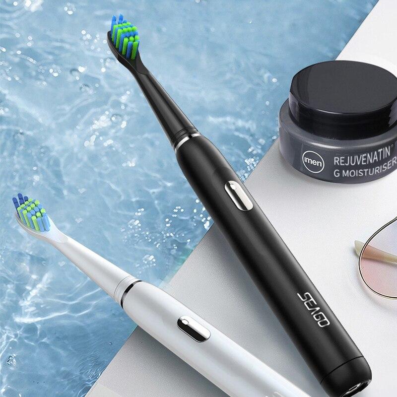 Купить с кэшбэком SEAGO Electric Toothbrush Rechargeable Buy One Get One Free Sonic Toothbrush 4 Mode Travel Toothbrush with 3 Brush Head Gift