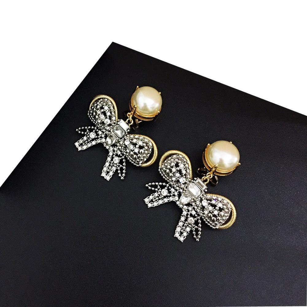 Mode rétro nouvelle fille mignonne perle et nœud pendentif oreille Clips femmes belle Simple bijoux accessoires cadeau