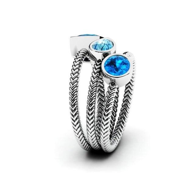 Купить женский набор обручальных колец серебряных с голубым цирконием картинки