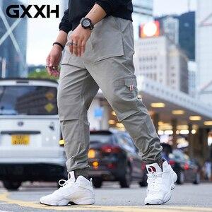 Image 1 - GXXH męskie szare spodnie joggery Streetwear ponadgabarytowe spodnie Cargo 2019 jesienne męskie duże kieszenie Ankel kombinezony luźne spodnie XXL 6XL