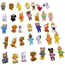 100 unids/lote muy lindo Col parche de muñecas mini de dibujos animados de pvc juguete para los niños mezclados al azar muñeca de 2-3cm juguete para niño