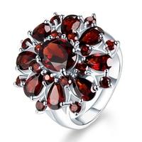 Ofertas Beliebte Trendy Silber Farbe Intarsien Granat Rot Zirkon Blume Form Damen Bankett Ring Schmuck Ganze Verkauf