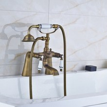 цена на Retro Antique Brass Double Ceramic Handles Deck Mounted Bathroom Clawfoot Bathtub Tub Faucet Mixer Tap w/Hand Shower aan013