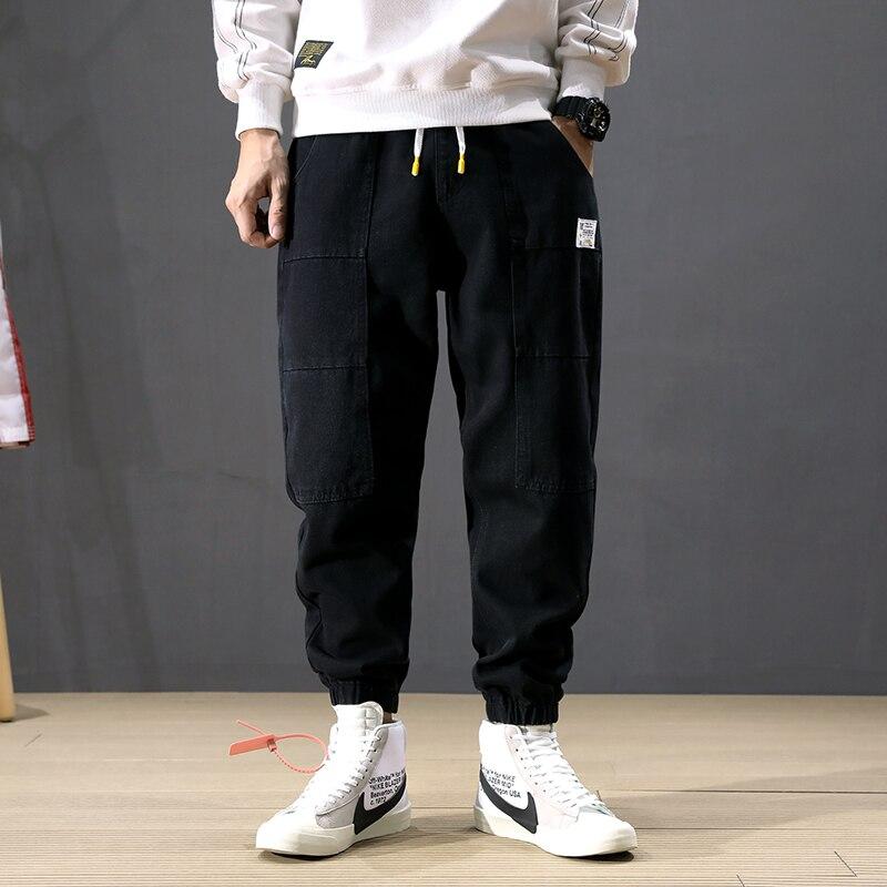 Korean Style Fashion Men Jeans Loose Fit Spliced Big Pocket Cargo Pants Black Harem Jeans Streetwear Hip Hop Joggers Jeans Men