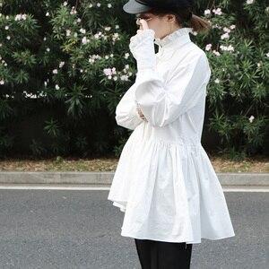 Image 5 - [EAM]2020 New Spring Autumn Stand Collar Long Sleeve White Loose Ruffles Stitch  Irregular Shirt Women Blouse Fashion Tide JL679