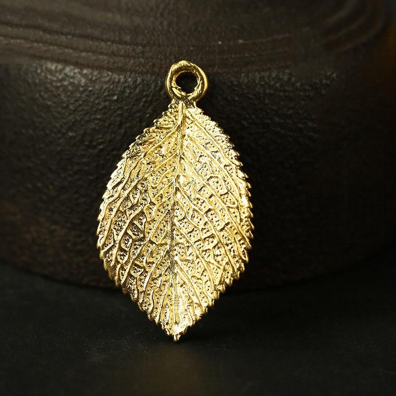 gold leaf charms (2)