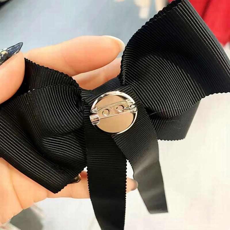 Semplice Stile Coreano Collegio Legame di Arco Dolce Nappa Spilla per Le Donne Vestito di Modo Camicia di Panno Corpetto Collare Dei Monili Accessori