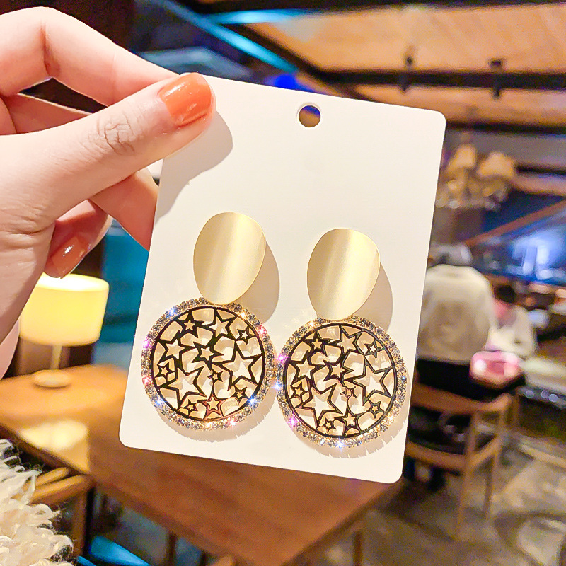 Metallic circle earring American vogue hollow out star eardrop web celebrity individual character wholesale contracted earring