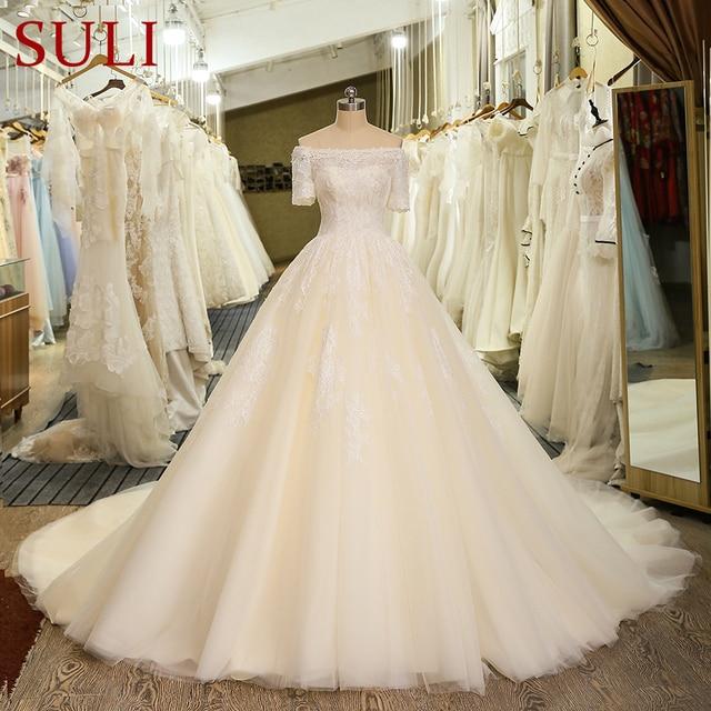 SL 6 Charming Short Sleeve Wedding Gowns Tulle Lace Appliques Vintage Boho Boat Neck Wedding Dress bridal gown suknie slubne