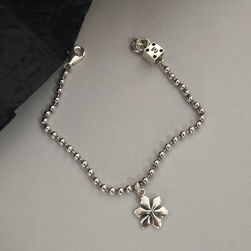 Купить женский серебряный браслет с цветком сливы в стиле индастриал