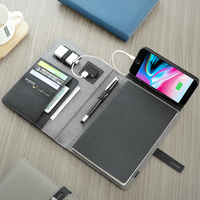 Multifuctional A5 business travel notebook composition book with 5000mAh power bank foldable mobile stand holder elastic belt