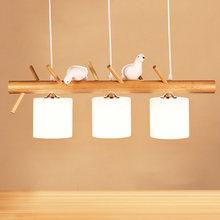 Люстра из массива дерева с птицами простой современный стеклянный