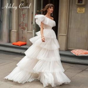 Image 1 - Ashley Carol One Shoulder Wedding Dresses 2020 Vestido De Noiva Tiered Ruffles Tulle Sleeveles Bride Beach A Line Bridal Gowns